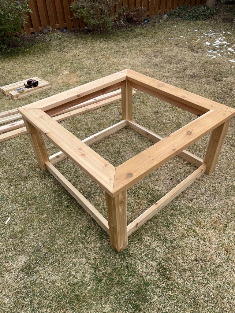 Adding the top frame to the raised garden bed