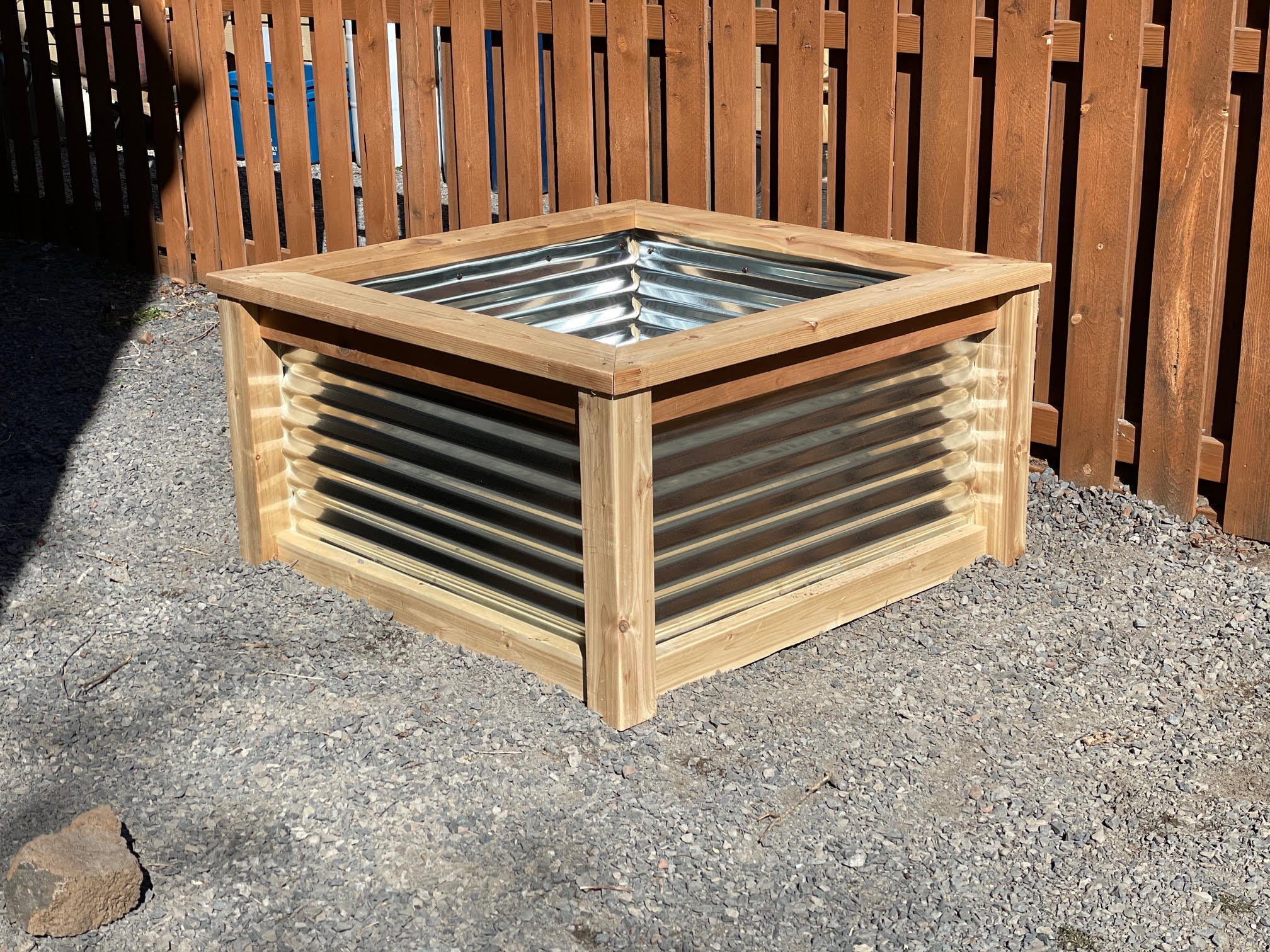 Adding corrugated metal to the raised garden bed